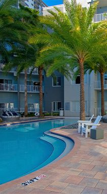 Bell Channelside apartments pool with lounge chairs